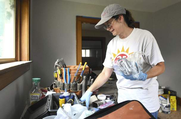 Michelle DaviesThe Journal Gazette Gayle Goodrich cleans up the work area of the home she is renovating on Terrace Road.