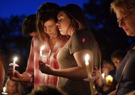 Associated Press In 2017, members of an Antioch, Tenn., church join a vigil for victims of a shooting. Police were informed earlier of the gunman's suicidal thoughts but were unable to take his guns away.