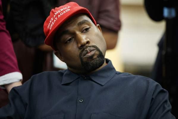 FILE - In this Oct. 11, 2018, file photo rapper Kanye West listens to a question from a reporter during a meeting in the Oval Office of the White House with President Donald Trump in Washington. (AP Photo/Evan Vucci, File)