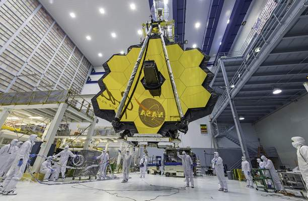 FILE - In this April 13, 2017 file photo provided by NASA, technicians lift the mirror of the James Webb Space Telescope using a crane at the Goddard Space Flight Center in Greenbelt, Md. (Laura Betz/NASA via AP, File)