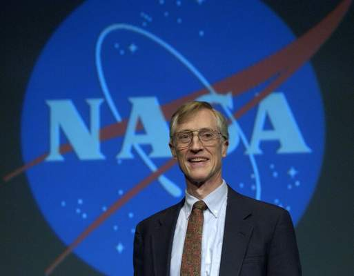 FILE - In this Oct. 3, 2006 file photo, Nobel Prize for Physics winner John Mather speaks at a news conference at NASA headquarters in Washington. (AP Photo/Kevin Wolf, File)