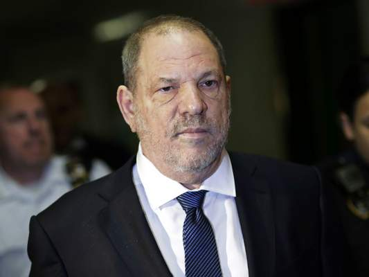 FILE - In this Oct. 11, 2018, file photo, Harvey Weinstein enters State Supreme Court in New York. (AP Photo/Mark Lennihan, File)