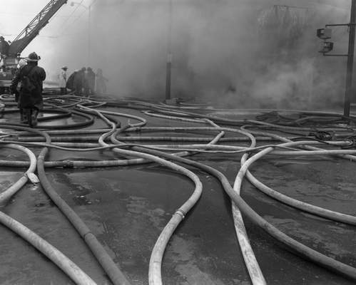 Feb. 19, 1957: Hoses snake across the intersection ofJefferson and Calhoun. The fire department had been phasing out old hoses, so nearly all of them were new. (Journal Gazette file)
