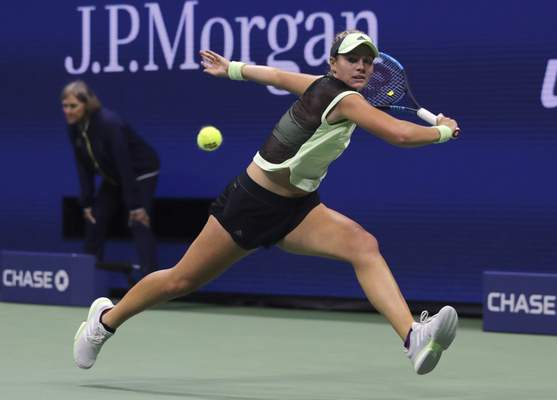 Caty McNally, of the United States, chases the ball on a shot from Serena Williams, of the United States, during the second round of the U.S. Open tennis tournament in New York, Wednesday, Aug. 28, 2019. (AP Photo/Charles Krupa)