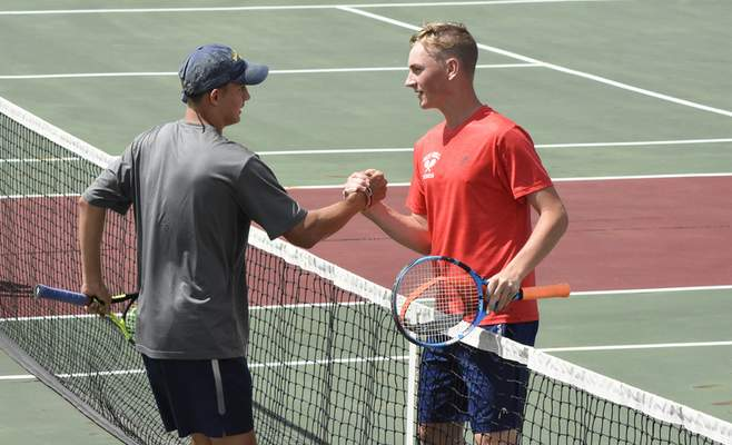 Rachel Von Stroup | The Journal Gazette Bellmont's Cole Shifferly, left, and West Noble's Joel Mast shake hands after their game at DeKalb on Saturday.