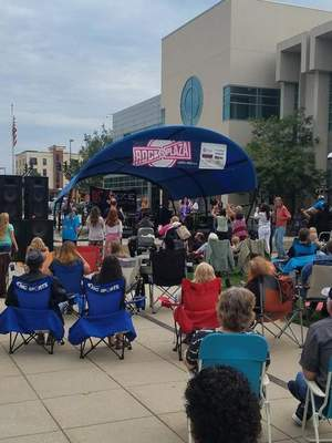 Gregg Bender | The Journal Gazette The band Bending Mercury kicks off Zep Fest at Rock the Plaza on Saturday evening at the Allen County Public Library. About 500 people attended the final Rock the Plazaconcert of 2019. Zep Fest featuredthree local bands playing the music of Led Zeppelin.