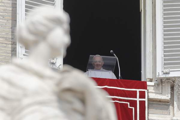 Pope Francis arrives to recites the Angelus noon prayer from the window of his studio overlooking St.Peter's Square, at the Vatican, Sunday, Sept. 1, 2019. (AP Photo/Alessandra Tarantino)