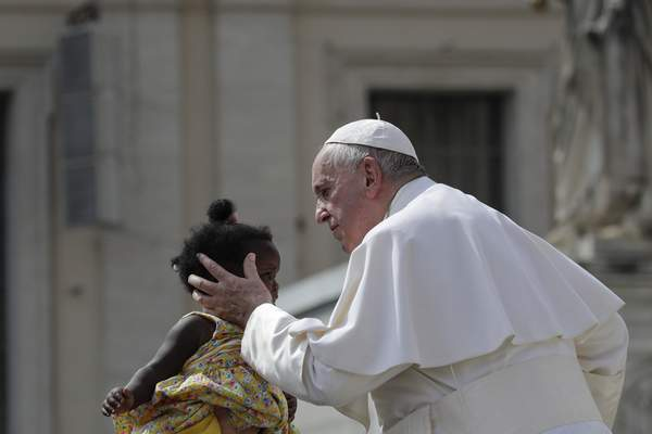 Pope Francis kisses a baby as he leaves St. Peter's Square at the Vatican after his weekly general audience, Wednesday, Aug. 28, 2019. (AP Photo/Alessandra Tarantino)