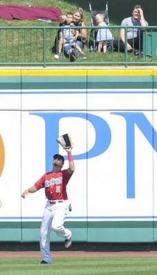 Michelle Davies | The Journal Gazette TinCaps' Jawuan Harris catches a fly ball hit by Lansing's Otto Lopez in the third inning of Monday's game at Parkview Field.