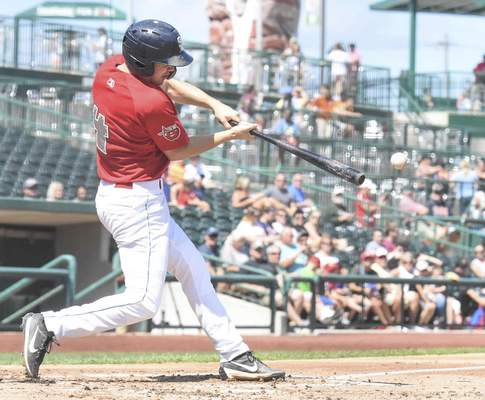 Michelle Davies | The Journal Gazette TinCaps' Chris Givin hits a foul ball in the third inning of Monday's game against Lansing at Parkview Field.