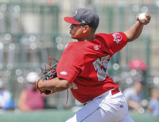 Michelle Davies | The Journal Gazette TinCaps' Efrain Contreras started out pitching in Monday's game against Lansing at Parkview Field.
