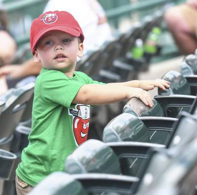 Michelle Davies | The Journal Gazette Carter Chalifoux, 2, of Fort Wayne, checks out the seating at Monday's TinCaps game at Parkview Field.