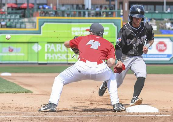 Michelle Davies | The Journal Gazette TinCaps' Chris Givin tries to tag Lansing's Rafael Lantigua at first in the fourth inning of Monday's game at Parkview Field.