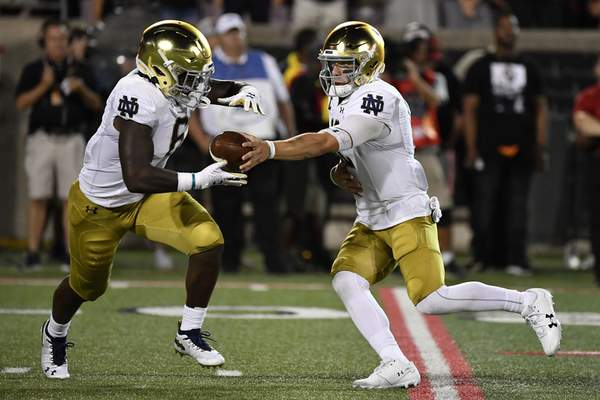 Notre Dame quarterback Ian Book (right)went 14 of 23 for 193 yards and a touchdown and ran for 81 yards and a score in the Irish's 35-17 Week 1 win over Louisville. (AP Photo/Timothy D. Easley)