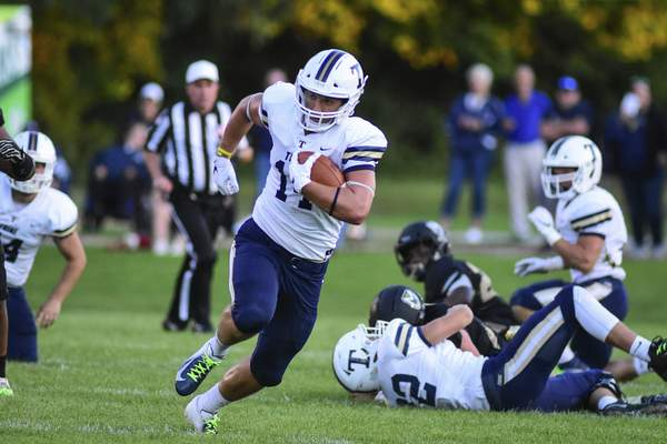 Mike Moore | The Journal Gazette Trine University tight end Adam Gutting carries the ball in the second quarter against Manchester University at Burt Field on Thursday.