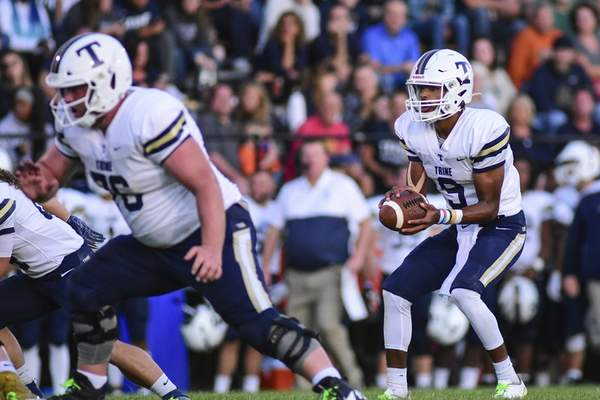 Mike Moore | The Journal Gazette Trine University quarterback Brandon Winters after snapping the ball in the second quarter against Manchester University at Burt Field on Thursday.