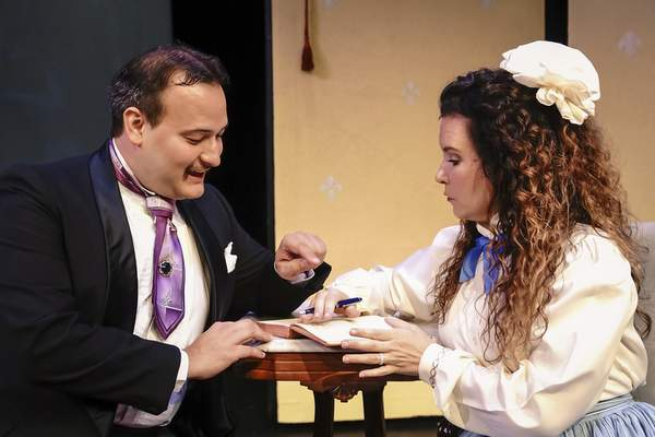 Mike Moore | The Journal Gazette Performers of the First Presbertarian Church's production of Importance of Being Earnest Aaron Mann, left as Algernon and Kelly Maloney as Cecily rehearse on stage on Tuesday 09.03.19