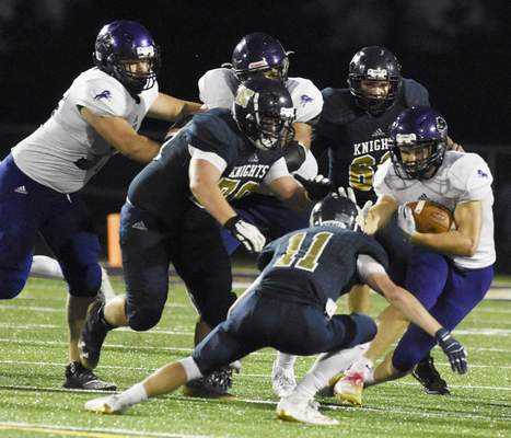 Rachel Von Stroup | The Journal Gazette Leo's Peyton Wall uses a stiff-arm to fend off a Norwell tackler during the third quarter against the Knights at Norwell on Friday night. The Lions won to stay undefeated at 3-0.