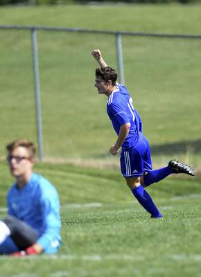 Katie Fyfe | The Journal Gazette  Carroll senior Samuel Michaels celebrates after getting a goal during the first half against Warsaw at Carroll High School on Saturday.