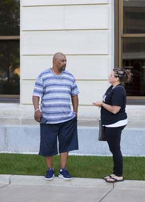 Katie Fyfe | The Journal Gazette  Leeroy Allison talks with Amy Miller Davis during the anti-gun rally at the Allen County Courthouse on Saturday, September 7th, 2019.