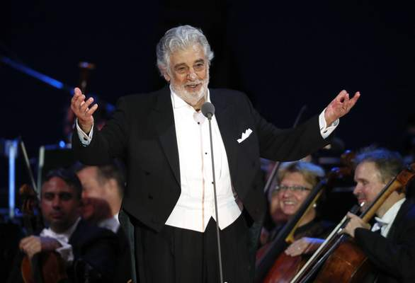FILE - In this Aug. 28, 2019 file photo, opera star Placido Domingo salutes spectators at the end of a concert in Szeged, Hungary. (AP Photo/Laszlo Balogh, File)