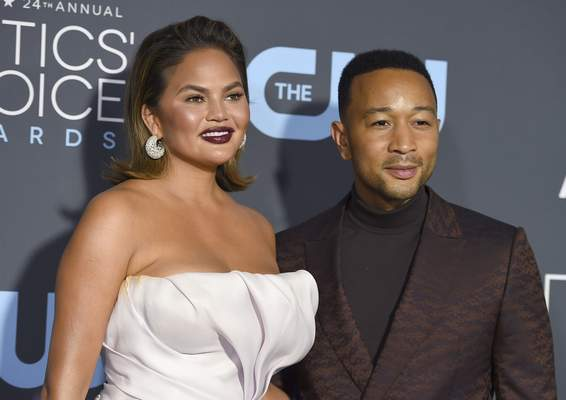 FILE - In this Jan. 13, 2019 file photo, Chrissy Teigen, left, and John Legend arrive at the 24th annual Critics' Choice Awards at the Barker Hangar in Santa Monica, Calif. (Photo by Jordan Strauss/Invision/AP, File)