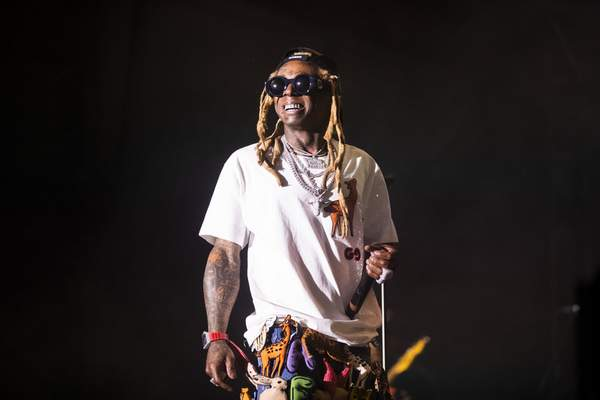 In this Saturday, Sept. 7, 2019 photo, Lil Wayne performs during his fifth annual Lil WeezyAna Fest at the UNO Lakefront Arena grounds in New Orleans. (Sophia Germer/The Advocate via AP)
