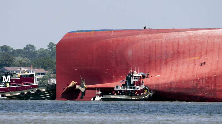 Associated Press Rescuers work near the stern of the vessel Golden Ray while rescuing four crew members Monday in Jekyll Island, Ga.
