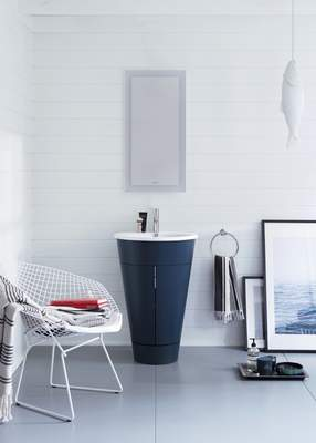 Duravit  Duravit's Starck 1 barrel vanity is now available in an inky blue. The color and unique shape make it a standout piece in bathrooms of any size.