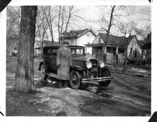 Carl Enz poses next to his car on Columbia Avenue in Fort Wayne in 1929.