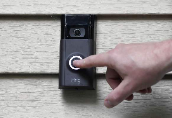 In this Tuesday, July 16, 2019, file photo, Ernie Field pushes the doorbell on his Ring doorbell camera at his home in Wolcott, Conn. (AP Photo/Jessica Hill, File)