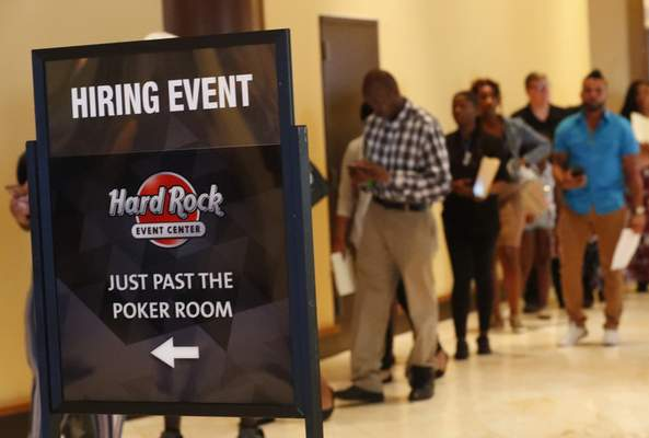 Associated Press Job applicants line up at the Seminole Hard Rock Hotel & Casino Hollywood during a job fair in Hollywood, Fla.