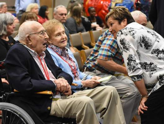 FILE: Nancy Harris, human resources manager at Do it Best, congratulates former CEO Don Wolf at the company celebration of his 90th birthday party Tuesday. Next to Wolf is his wife of 70 years, Ginny.