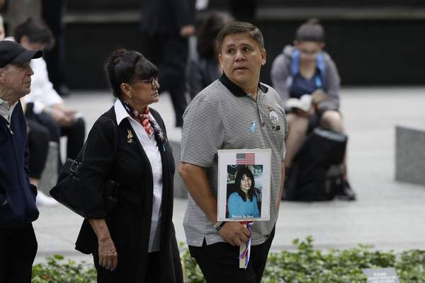 People gather for a ceremony marking the 18th anniversary of the attacks of Sept. 11, 2001 at the National September 11 Memorial, Wednesday, Sept. 11, 2019 in New York. (AP Photo/Mark Lennihan)