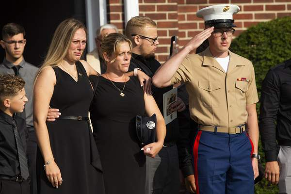 Kiersten Haub, from left, Erika Starke, and Michael Haub, family members of New York firefighter Michael Haub, attend a second funeral service for him in Franklin Square, N.Y., Tuesday, Sept. 10, 2019. (AP Photo/Eduardo Munoz Alvarez)