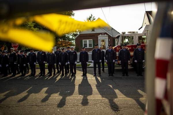 New York Fire Department members attend a second funeral service for FDNY firefighter Michael Haub in Franklin Square, N.Y., Tuesday, Sept. 10, 2019. (AP Photo/Eduardo Munoz Alvarez)