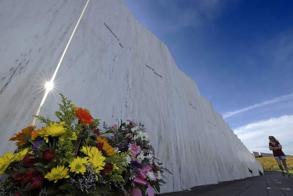 A visitor to the Flight 93 National Memorial in Shanksville, Pa., views the Wall of Names on Tuesday, Sept. 10, 2019, as the nation prepares to mark the 18th anniversary of the Sept. 11, 2001 attacks. (AP Photo/Gene J. Puskar)