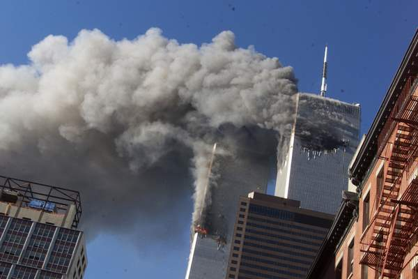 FILE - In this Sept. 11, 2001, file photo, smoke rises from the burning twin towers of the World Trade Center after hijacked planes crashed into the towers in New York City. (AP Photo/Richard Drew, File)