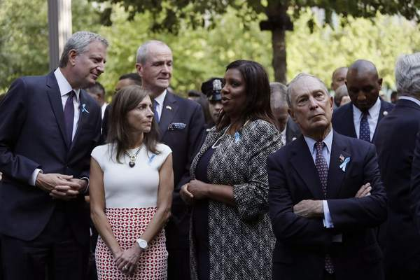 Attending the ceremony marking the 18th anniversary of the attacks of Sept. 11, 2001 are, from left, New York Mayor Bill de Blasio, Tammy Murphy and her husband New Jersey Gov. Phil Murphy, New York State Attorney General Letitia James, and former Mayor Michael Bloomberg, at the National September 11 Memorial, Wednesday, Sept. 11, 2019 in New York. (AP Photo/Mark Lennihan)
