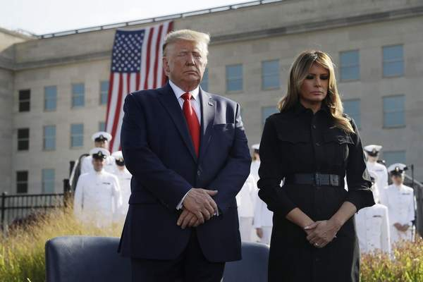 President Donald Trump and first lady Melania Trump participate in a moment of silence honoring the victims of the Sept. 11 terrorist attacks, Wednesday, Sept. 11, 2019, at the Pentagon. (AP Photo/Evan Vucci)