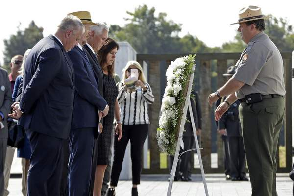 Vice President Mike Pence, third from left, and second lady Karen Pence, fourth from left, are joined by President of Families of Flight 93, Gordon Felt, second from left, and Secretary of the Interior David Bernhardt, left, in placing a wreath at the Wall of Names following the September 11th Flight 93 Memorial Service at the Flight 93 National Memorial in Shanksville, Pa., Wednesday, Sept. 11, 2019, the 18th anniversary of the attacks. Felt's brother Edward Felt was one of the 40 passenger and crew killed on Flight 93. (AP Photo/Gene J. Puskar)