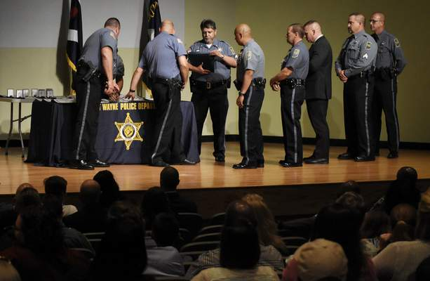Members of the Fort Wayne Police Department accept a Community Service Citation award during the 2019 Annual Awards Ceremony at the Public Safety Academy on Wednesday. (Rachel Von Stroup | The Journal Gazette)