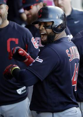 Cleveland Indians' Carlos Santana celebrates in the dugout after his solo home run against the Los Angeles Angels during the first inning of a baseball game Wednesday, Sept. 11, 2019, in Anaheim, Calif. (AP Photo/Marcio Jose Sanchez)