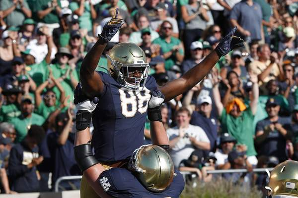 Notre Dame wide receiver Javon McKinley (88) celebrates one of his two touchdown catches Saturday in Notre Dame's 66-14 win over New Mexico. He came into the game with just one career reception.(AP Photo/Paul Sancya)