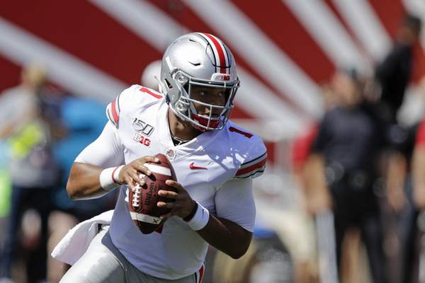 Ohio State quarterback Justin Fields (1) looks to throw during the first half of an NCAA college football game against Indiana, Saturday, Sept. 14, 2019, in Bloomington, Ind. (AP Photo/Darron Cummings)