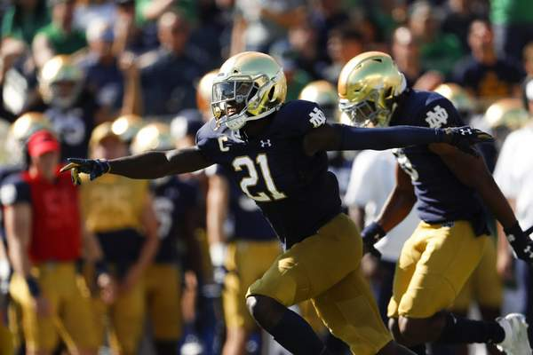 Associated Press photos Notre Dame safety Jalen Elliott celebrates after his interception in the second quarter of Saturday's romp over New Mexico at Notre Dame Stadium in South Bend.