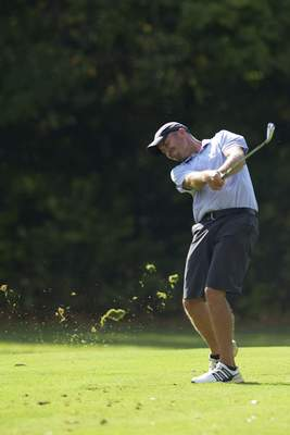 Photos by Katie Fyfe | The Journal Gazette Dave Dumas hits a shot on the 10th hole during the final round of the Senior City Championship on Monday at Orchard Ridge. Dumas shot an even-par 71 to repeat as champion.