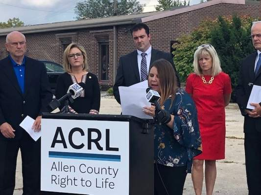 Serena Dyksen of Elkhart speaks Monday at a news conference outside Dr. Ulrich Klopfer's former abortion clinic on Inwood Drive. (Brian Francisco | The Journal Gazette)