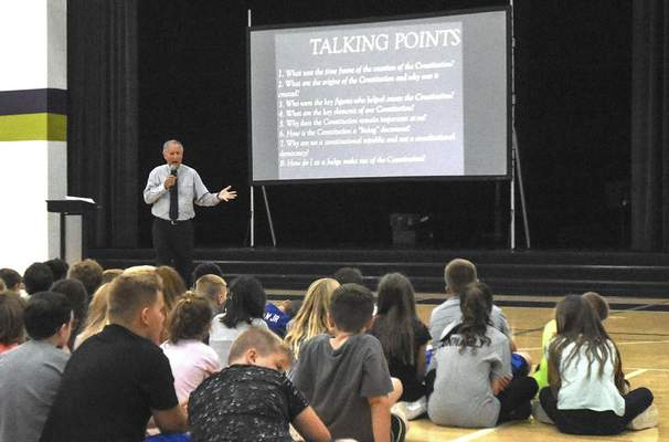 Michelle Davies | The Journal Gazette Retired Allen County Superior Court Judge Dan Heath speaks Tuesday at Leo Elementary School to commemorate Constitution Day. Heath spoke to the students about the U.S. Constitution and how it guides judges when deciding cases.
