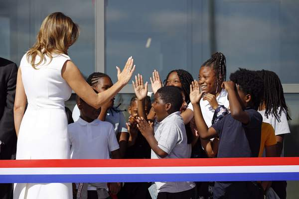 Associated Press First lady Melania Trump high-fives students from Amidon-Bowen Elementary School in Washington as she arrives at a ribbon-cutting ceremony Thursday to reopen the Washington Monument.